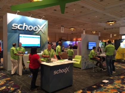 Photo of Conference Exhibitors and Attendees at SchooX Booth at DevLearn Conference and Expo 2018